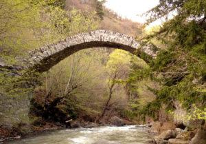 Rkoni medieval bridge in Georgia, seen on John Graham Tours.