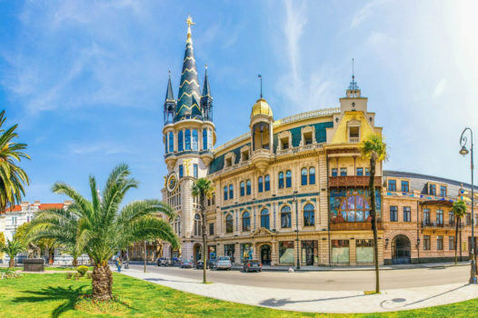 Downtown Batumi on the Black Sea coastline with the Adjara mountains entering the sea, seen on the Viticulture and Highlands West tour organized by John Graham Tours.