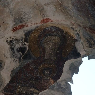 The ceiling frescoes, with gaping hole in the roof before recent repairs